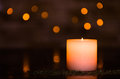 Moody candlelight with a nice fuzzy light bokeh. Perfect for the spa. Royalty Free Stock Photo