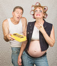 Moody pregant lady and man redneck hillbilly pregnant couple with candy Royalty Free Stock Photo