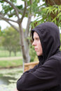 Moody teenager deep in thought Royalty Free Stock Photo
