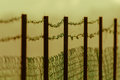 Moody Wire Fencing Royalty Free Stock Photo
