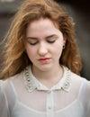 Mooi ginger teenage girl looking down Stock Afbeeldingen