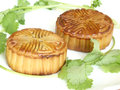 The moon cake and coriander chinese cilantro in white background food for chinese mid autumn festival Royalty Free Stock Image