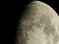 Moon craters close up of the at night waxing gibbous illuminated Royalty Free Stock Photography