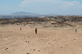 Moon Landscape in Welwitschia Plains with People Walking Royalty Free Stock Photo