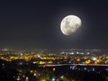 Moon light night city view of a huge and densely populated metropolitan or or town with bright lights and dark sky and clear half Royalty Free Stock Photography