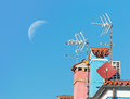 Moon over antennas Royalty Free Stock Image