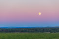 Moon over the field and forest summer night Royalty Free Stock Photo
