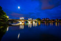 The moon over the John W Weeks Bridge and Charles River at night Royalty Free Stock Photo