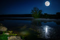Moon over lake scenic nighttime landscape with full rising the Royalty Free Stock Images