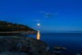 Moon over the sea in HDR Royalty Free Stock Photo