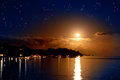 The moon over the sea and reflection in water Royalty Free Stock Photo