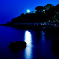 Moon over the sea with reflections in water Royalty Free Stock Photo