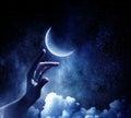 Moon planet in hand . Mixed media Royalty Free Stock Photo