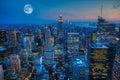 Moon rising over Manhattan Royalty Free Stock Photo