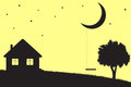 Moon swings hanging from the house and tree silhouettes Royalty Free Stock Photo