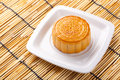 Mooncake and tea on bamboo background Royalty Free Stock Photo