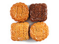 Mooncakes close up of four isolated on white background the chinese words indicates the type of mooncake not the brand Royalty Free Stock Image