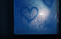 Moonlight through the window sweaty glass and heart shape Royalty Free Stock Photo