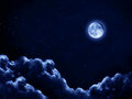 Moonlit night sky the moon shines on a with clouds Stock Images