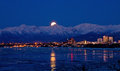 Moonrise over anchorage alaska the moon rises from behind the chugach mountains Stock Images
