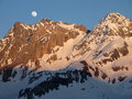 Moonrise during the sunset in french alps beautiful just above the summits Royalty Free Stock Photography