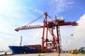 Moored container ship and cranes in a harbor Royalty Free Stock Photos
