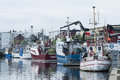Moored fishingboats simrishamn sweden in commercial fishing harbour scania swedish skåne Royalty Free Stock Photography