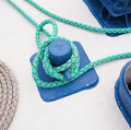 Mooring bollard with green rope close up of in marina Stock Images