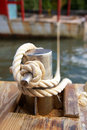 Mooring bollard with nautical rope Royalty Free Stock Photos