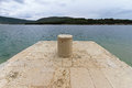 Mooring bollard post at pier for docking ships Royalty Free Stock Photography