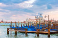 Mooring for gondolas in venice italy on piazza san marco at sunset basilica of saint mary of health or basilica di santa maria Royalty Free Stock Images