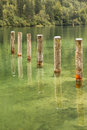 Mooring poles at st bartholoma pier konigssee germany row of Stock Images