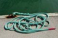 Mooring rope green tied around steel anchor Royalty Free Stock Photography