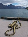 Mooring rope and scenic view over the lake Royalty Free Stock Images