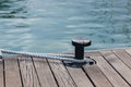 Mooring rope tied around steel anchor yachting Royalty Free Stock Photos