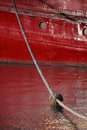 Mooring Rope to Red Tugboat Royalty Free Stock Photo