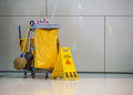 Mop bucket and caution sign Royalty Free Stock Photo
