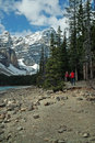Moraine lake banff national park alberta canada hikers explore the shore of Royalty Free Stock Photo