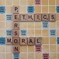 Moral and ethics wooden letters from scrabble game making crosswords person Royalty Free Stock Photos