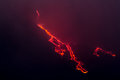 More explosions in the night and lava flow Stock Images