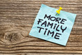 More family time reminder note against grained weathered wood Royalty Free Stock Photos