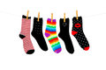 More orphan socks odd whose mates have been lost hanging on a clothesline shot on white background Royalty Free Stock Photography