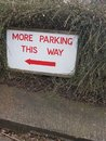 More parking this way sign. Royalty Free Stock Photo