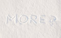 More? - written in snow Stock Photo