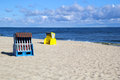 A morning at the baltic sea empty roofed wicker beach chairs usedom beach Stock Photography