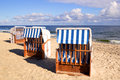 A morning at the baltic sea empty roofed wicker beach chairs usedom beach Royalty Free Stock Photos