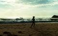 Morning beach jog Royalty Free Stock Photo