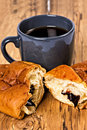 Morning breakfast with cup of coffee and croissant on wooden table Royalty Free Stock Image