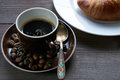 Morning breakfast for a good morning is a croissant and cup of coffee espresso Royalty Free Stock Photo