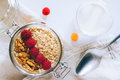Morning breakfast, oatmeal with red and yellow raspberries Royalty Free Stock Photo